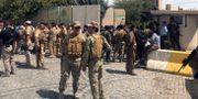 Kurdiska säkerhetsstyrkor nära regeringsbyggnaden i Erbil som attackerats.  AZAD LASHKARI / TT NYHETSBYRÅN