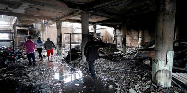 Sex personer ska ha dött när deras hus brann ner. INTI OCON / AFP