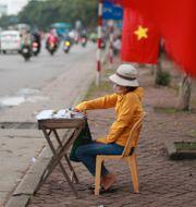 Illustrationsbild: Lotteriförsäljare i Hanoi. Hau Dinh / TT NYHETSBYRÅN