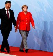 Illustrationsbild: Kinas ledare Xi och Tysklands dito Merkel. Wolfgang Rattay / TT NYHETSBYRÅN