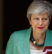 Theresa May TOLGA AKMEN / AFP