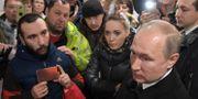 Putin möter lokalinvånare i Kemerovo. Alexei Druzhinin / TT NYHETSBYRÅN