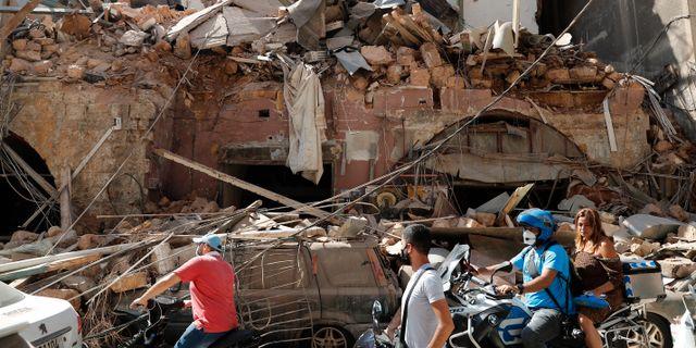 Skadade hus efter explosionerna i Beirut.  Hussein Malla / TT NYHETSBYRÅN