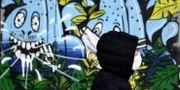 Joggare med ansiktsmask i Paris. FRANCK FIFE / TT NYHETSBYRÅN