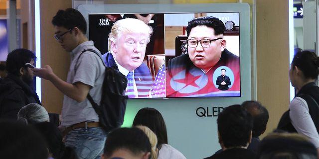 Arkivbild: Trump och Kim på sydkoreansk tv. TT