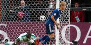Keisuke Honda gjorde Japans 2–2-mål. MAX ROSSI / BILDBYR N