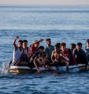 Migranter från Marocko anländer i båt vid den spanska gränsen. Bernat Armangue / TT NYHETSBYRÅN