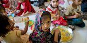 Barn från muslimska familjer som sökt skydd i ett flyktingcenter av rädsla för hämndattacker Gemunu Amarasinghe / TT NYHETSBYRÅN