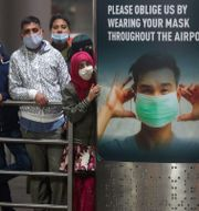 People wearing face masks as a precaution against the coronavirus wait for their relatives arriving from United Kingdom, at Chhatrapati Shivaji Maharaj International Airport in Mumbai, India, Tuesday, Dec. 22, 2020. Rafiq Maqbool / TT NYHETSBYRÅN