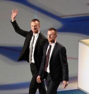 Henrik och Daniel Sedin under en ceremoni Vancouver.  DARRYL DYCK / TT NYHETSBYRÅN