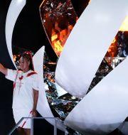 Naomi Osaka efter att ha tänt den olympiska elden på arenan vid öppningen Ashley Landis / TT NYHETSBYRÅN