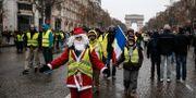 Bild från Champs-Elysees på lördagen. ABDUL ABEISSA / AFP