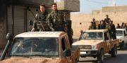 Syriska rebellstyrkor som stöds av Turkiet vid Aleppo idag. NAZEER AL-KHATIB / AFP