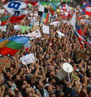 Protester i Chiles huvudstad Santiago 2019. IVAN ALVARADO / TT NYHETSBYRÅN