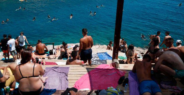 Turister i Grekland. Thanassis Stavrakis / TT NYHETSBYRÅN
