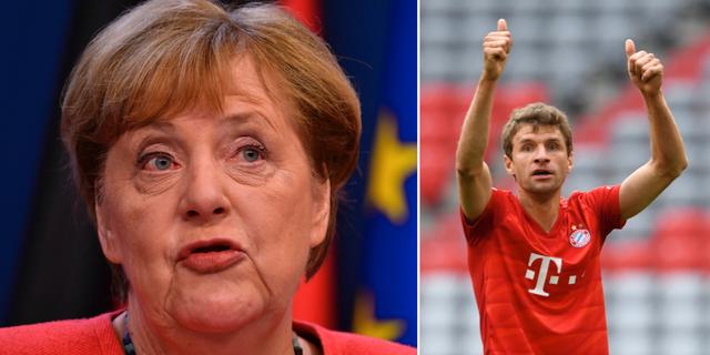 Angela Merkel och den tyska mittfältaren Thomas Müller. TT