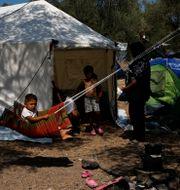 Temporärt läger efter Moria förstörts. Petros Giannakouris / TT NYHETSBYRÅN