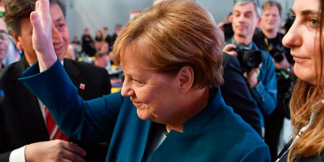 Angela Merkel på plats på CDU-kongressen. JOHN MACDOUGALL / AFP