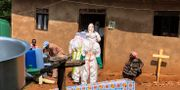Ebolaarbetare i Kongo. Al-hadji Kudra Maliro/TT
