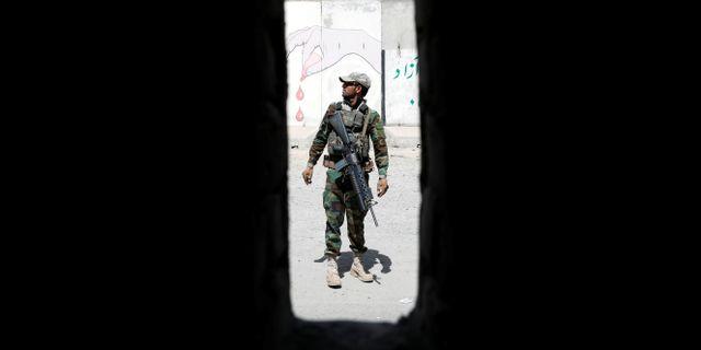 En afghansk soldat. MOHAMMAD ISMAIL / TT NYHETSBYRÅN
