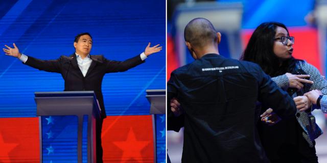 Andrew Yang under debatten/en demonstrant stoppades när hon försökte storma scenen tillsammans med en man. TT