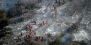 Förödelse efter att en brand dragit fram i Mandeville Canyon i Kalifornien.  Marcio Jose Sanchez / TT NYHETSBYRÅN