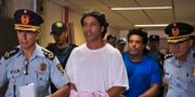 Ronaldinho och hans bror Roberto Assis på väg till häktningsförhandling.  NORBERTO DUARTE / TT NYHETSBYRÅN