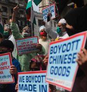 Protester i Indien.  Rafiq Maqbool / TT NYHETSBYRÅN