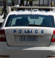En grekisk polisbil. Arkivbild. Thanassis Stavrakis / TT NYHETSBYRÅN