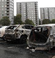 Utbrända bilar i Frölunda. Adam Ihse/TT / TT NYHETSBYRÅN