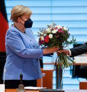 CDU:s Angela Merkel och SPD:s Olaf Scholz har ingått i samma regering under de senate åren. Axel Schmidt / TT NYHETSBYRÅN