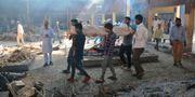 En kropp som ska kremeras efter olyckan i indiska Amritsar. Prabhjot Gill / TT NYHETSBYRÅN/ NTB Scanpix