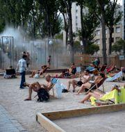 Värmeböljan i Paris. Kamil Zihnioglu / TT NYHETSBYRÅN