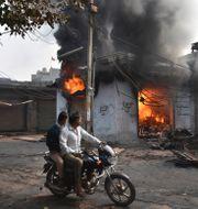 Bild från New Dehli.  Dinesh Joshi / TT NYHETSBYRÅN