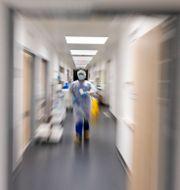 En stressad sjuksköterska. Frank Molter / TT NYHETSBYRÅN
