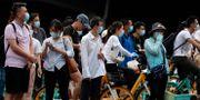 Invånare i Peking. Andy Wong / TT NYHETSBYRÅN