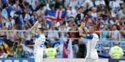 Isländska spelare och fans firade 1–1-matchen mot Argentina i första gruppspelsmatchen. TT