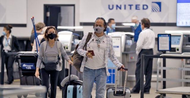 Resenärer i USA. Chris O'Meara / TT NYHETSBYRÅN