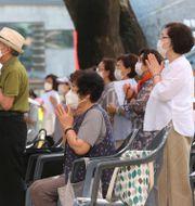 Personer med mask i Sydkorea. Ahn Young-joon / TT NYHETSBYRÅN