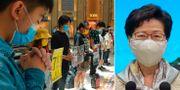 Människor demonstrerar mot den nya lagen/Carrie Lam TT