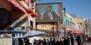Xi Jinping på en storskärm i Hotan i västra Kina.  Ng Han Guan / TT NYHETSBYRÅN