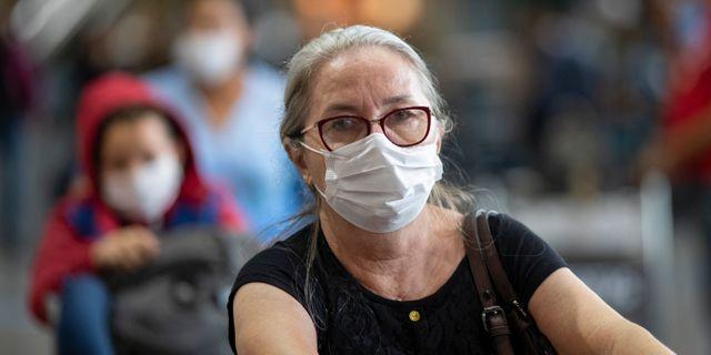 Kvinna i Sao Paulo.  Andre Penner / TT NYHETSBYRÅN