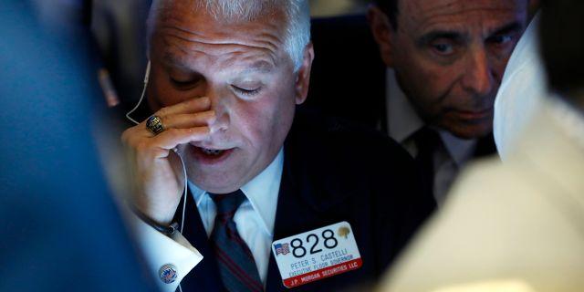 Peter Castelli, handlare på New York-börsen. Richard Drew / TT NYHETSBYRÅN/ NTB Scanpix