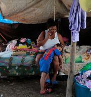Wendy Guadalupe Contrera blev hemlös i den senaste stormen, nu inväntar hon nästa. Delmer Martinez / TT NYHETSBYRÅN