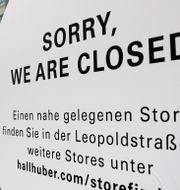 Illustrationsbild: Skylt utanför klädbutik i tyska München.  Matthias Schrader / TT NYHETSBYRÅN