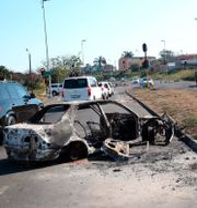 Utbrunna bilar i Durban. TT NYHETSBYRÅN