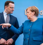 Jens Spahn tillsammans med förbundskansler Angela Merkel.  TT.