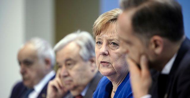 António Guterres och Angela Merkel. POOL / TT NYHETSBYRÅN