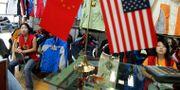 Arkivbild: Kinesiska försäljare i Peking. NG HAN GUAN / AP