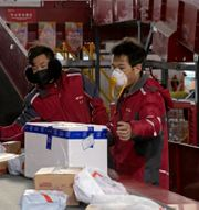 Illustrationsbild. Anställda vid kinesiska e-handelsjätten JD.com.  Ng Han Guan / TT NYHETSBYRÅN